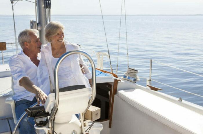 Senior couple on sailboat with a calm sea