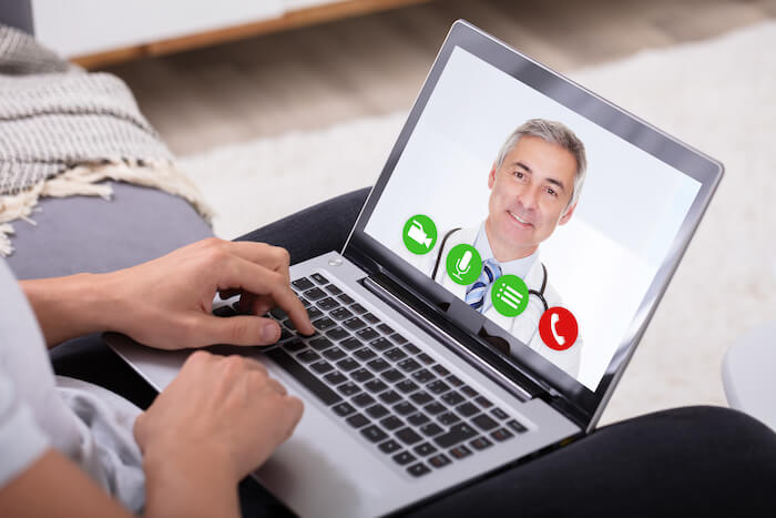 Telemedicine, Doctor on computer screen doing a virtual appointment